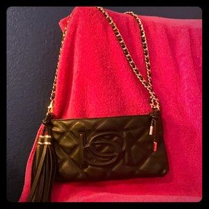 Bebe clutch and shoulder bag